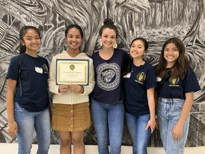Five students pose for picture with Distinguished Chapter award for Beta Chi Omega, Phi Theta Kappa Chapter on March 7, 2020
