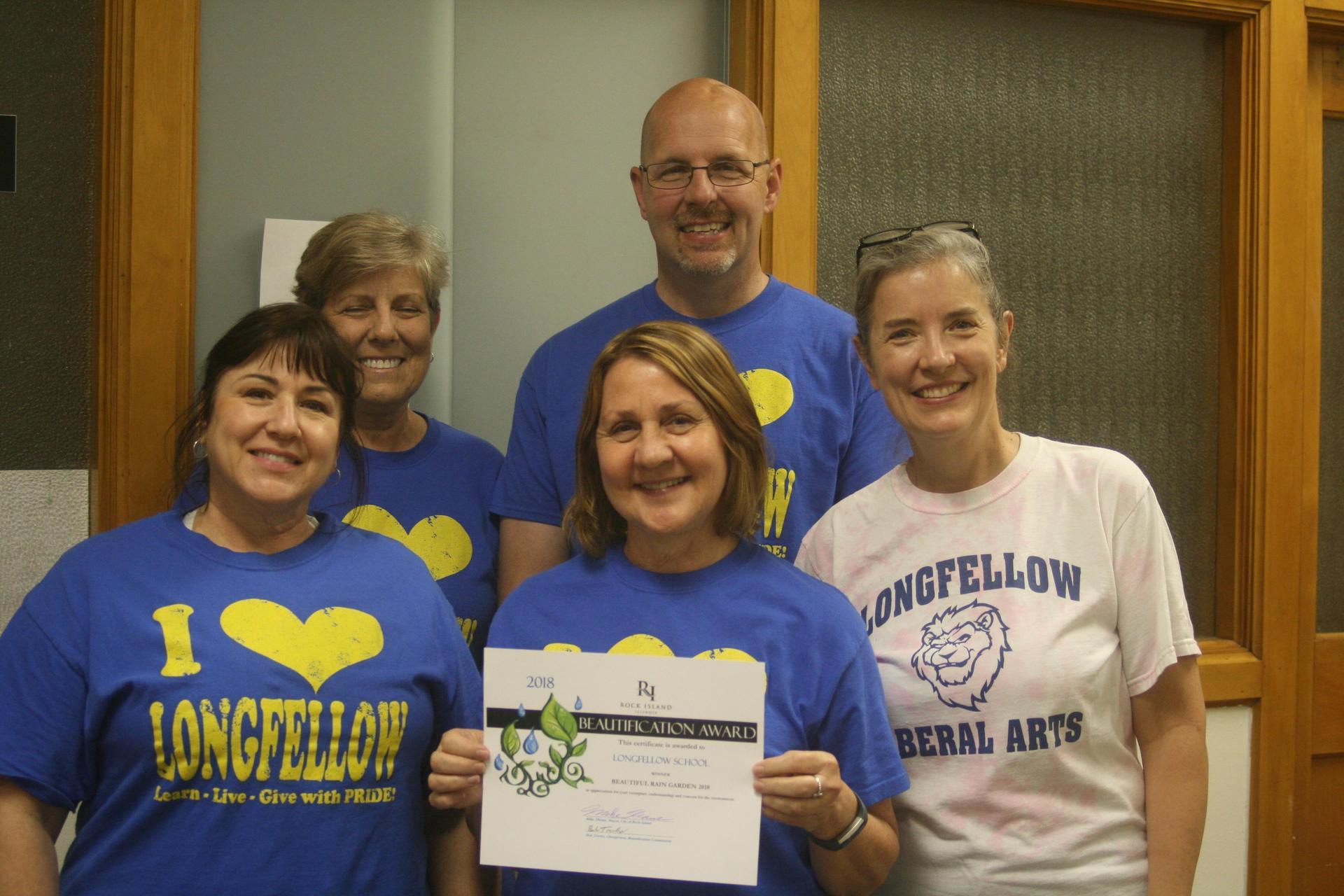 longfellow staff with award