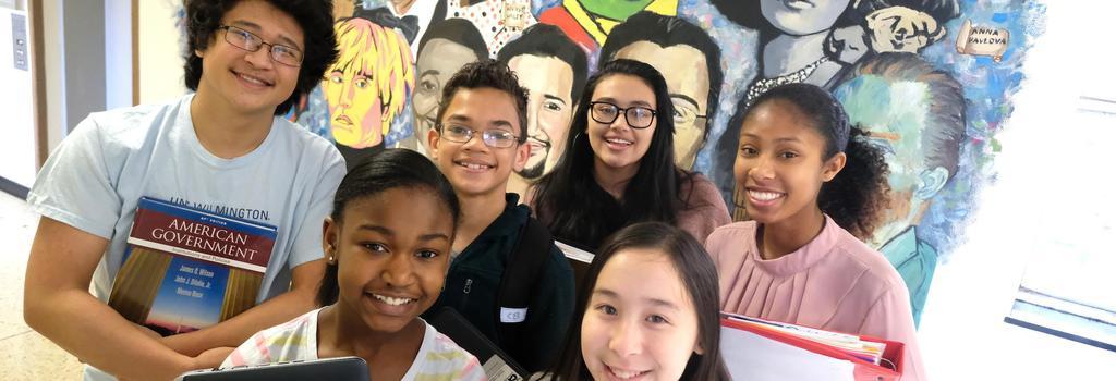 Students in front of school mural