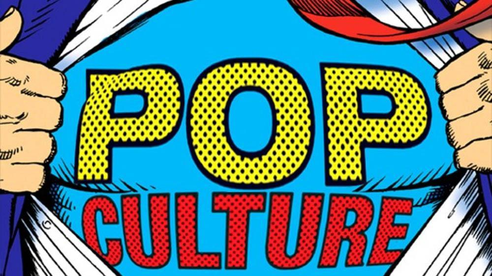 "the words ""pop culture"" on a cartoon man's shirt"
