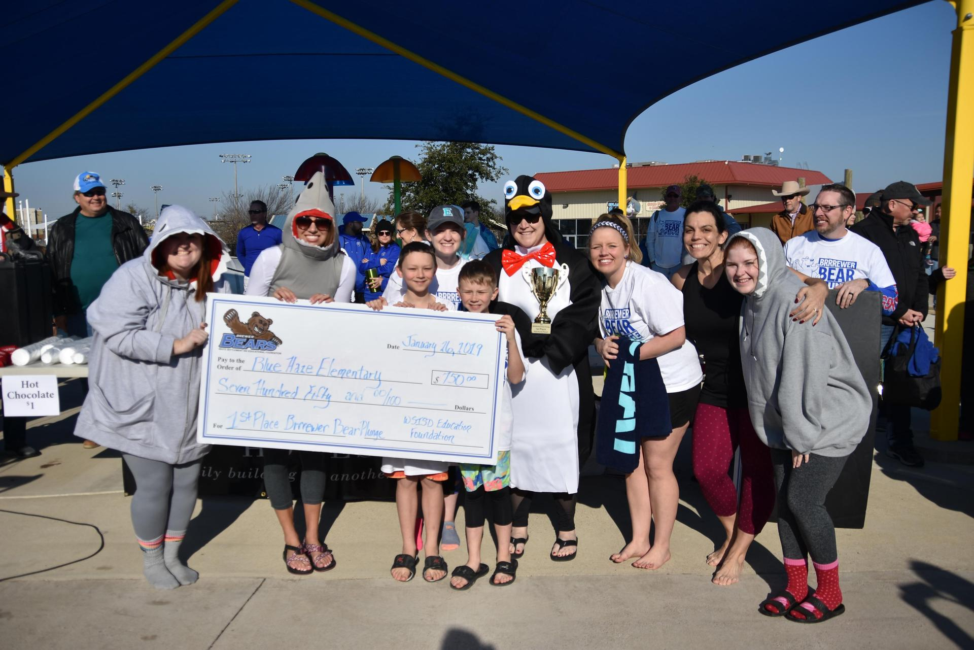 Blue Haze Elementary won $750 during the 3rd annual BRRRewer Bear Plunge.