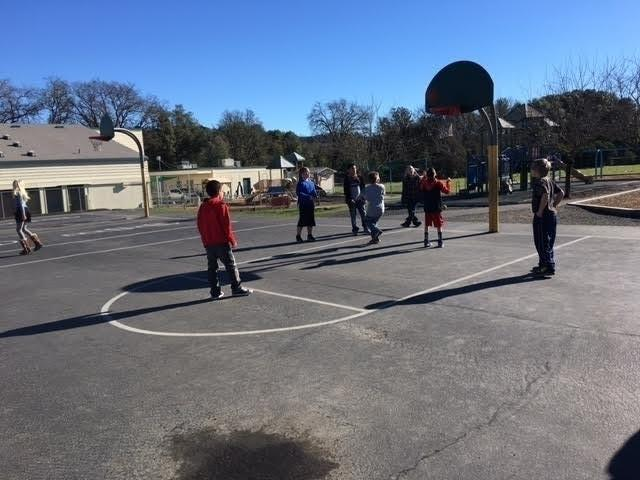 Kids play on the basketball courts