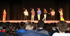 Roosevelt students try their hands at spinning/balancing plates during an assembly by Dance China New York (DCNY).