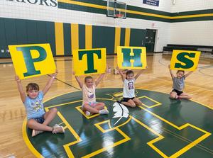 campers hold cheer signs