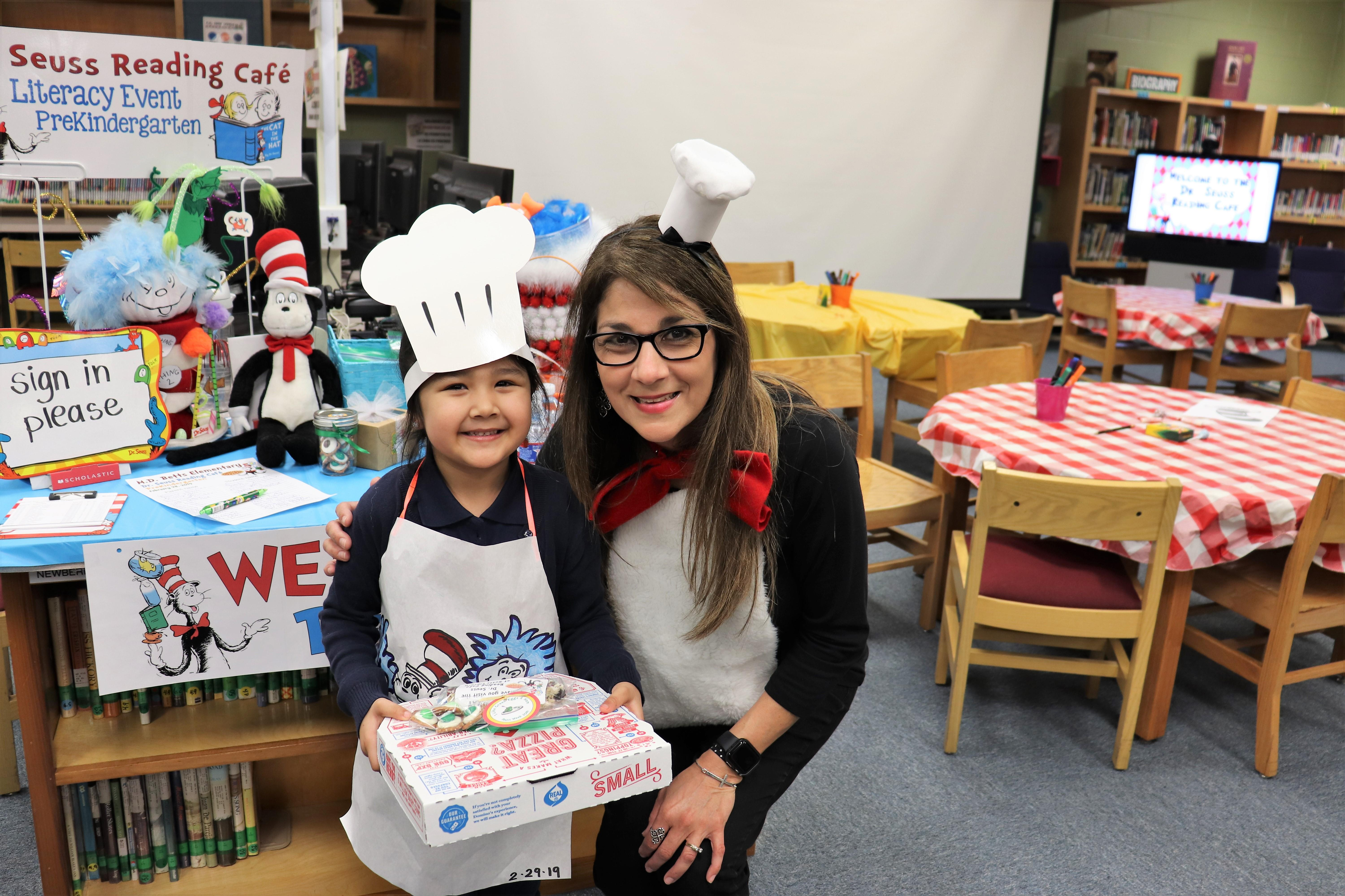 Image of PreK student and Mrs. Mendoza