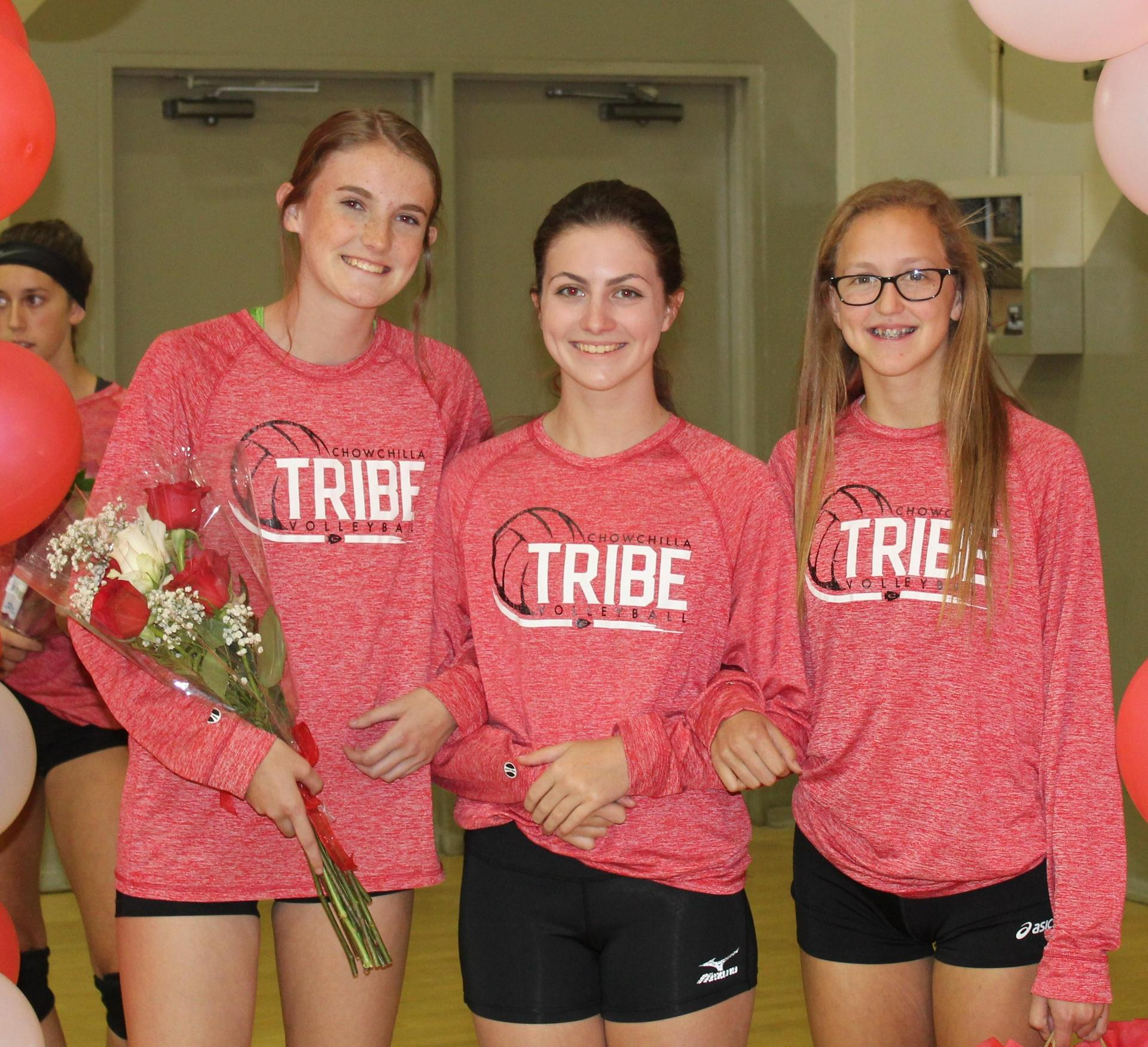 Sami Eastton and Lauren Bass escort Emily Seals on Volleyball Senior Night.