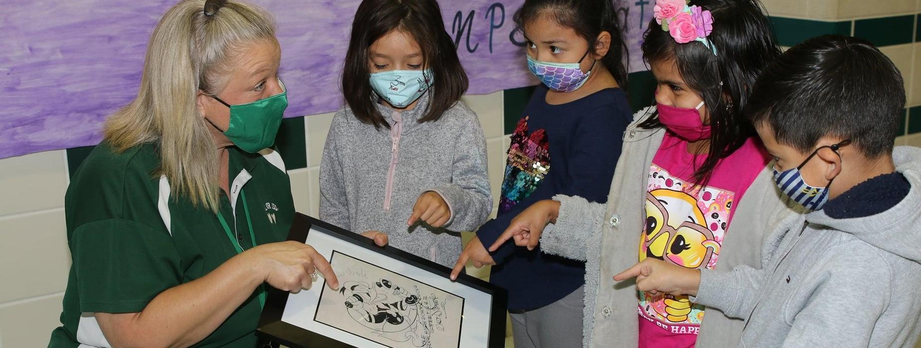 students look at Walt Disney drawing