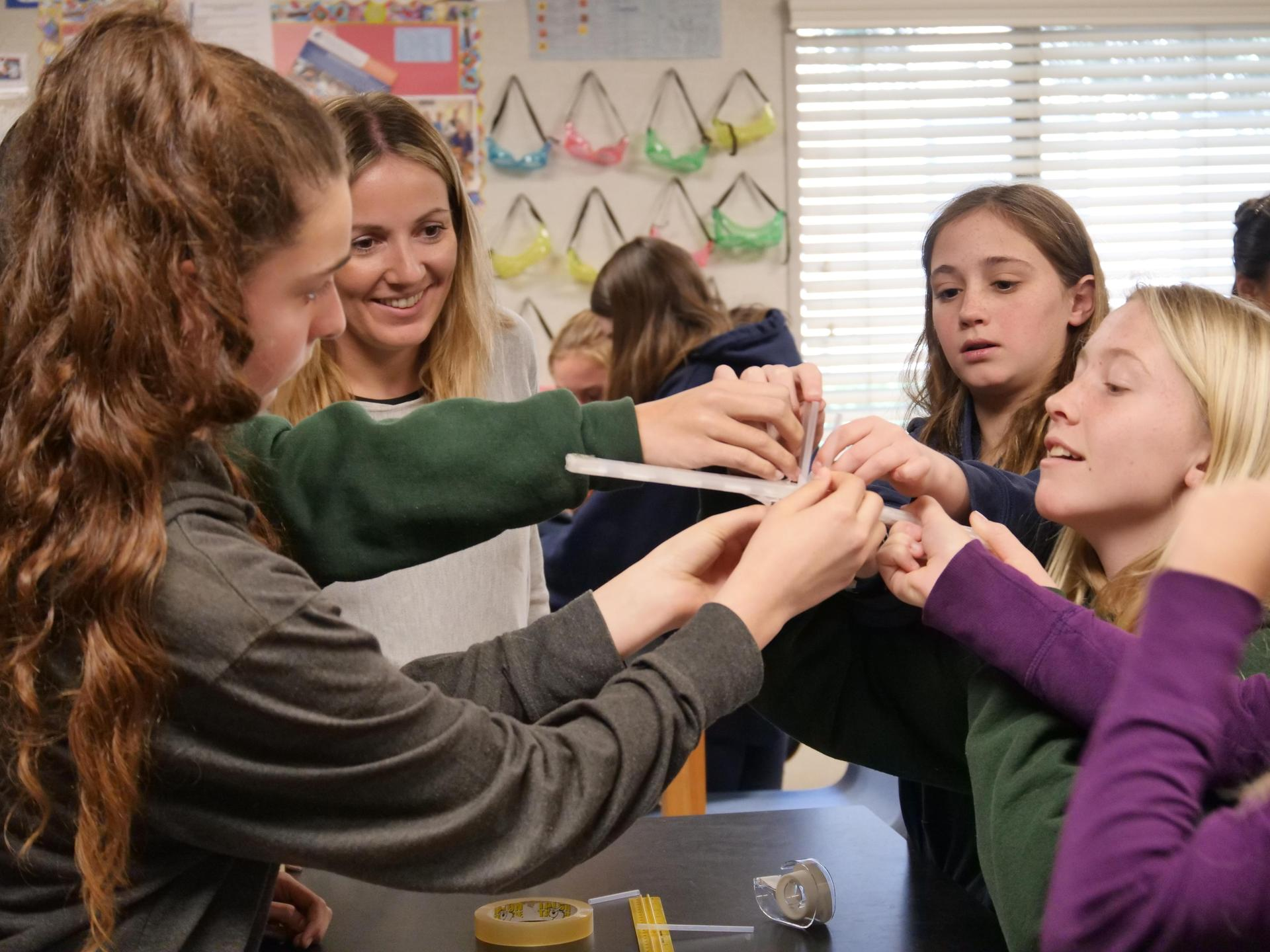 Middle school students take part in a group STEM activity.