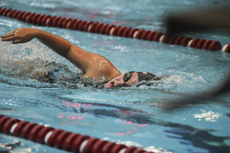 girl swimming freestyle race at Naugatuck High School pool