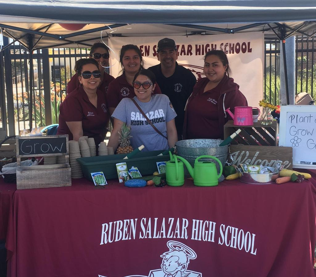 Salazar staff and students pose at the school's booth.