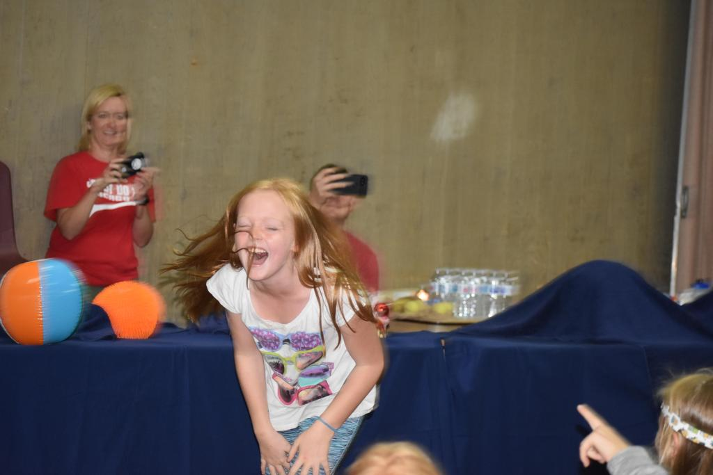 Student participating in a name that ball contest