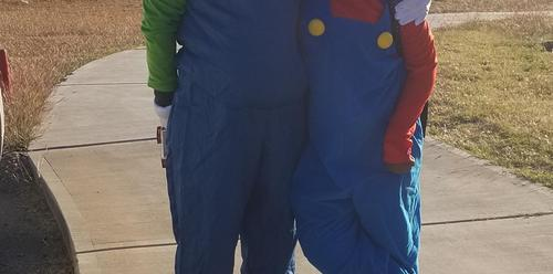 dad and son dressed like Mario Brothers