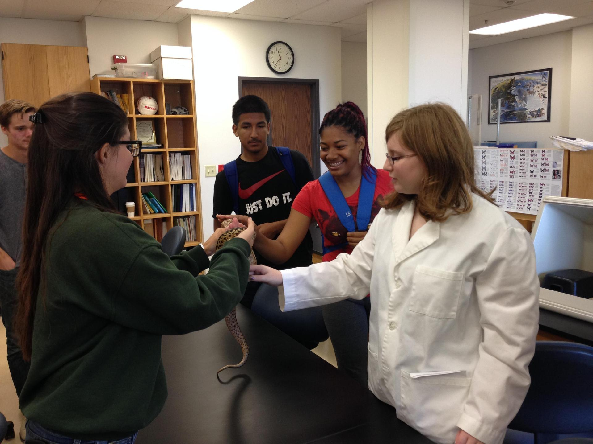 South LA students touching a snake