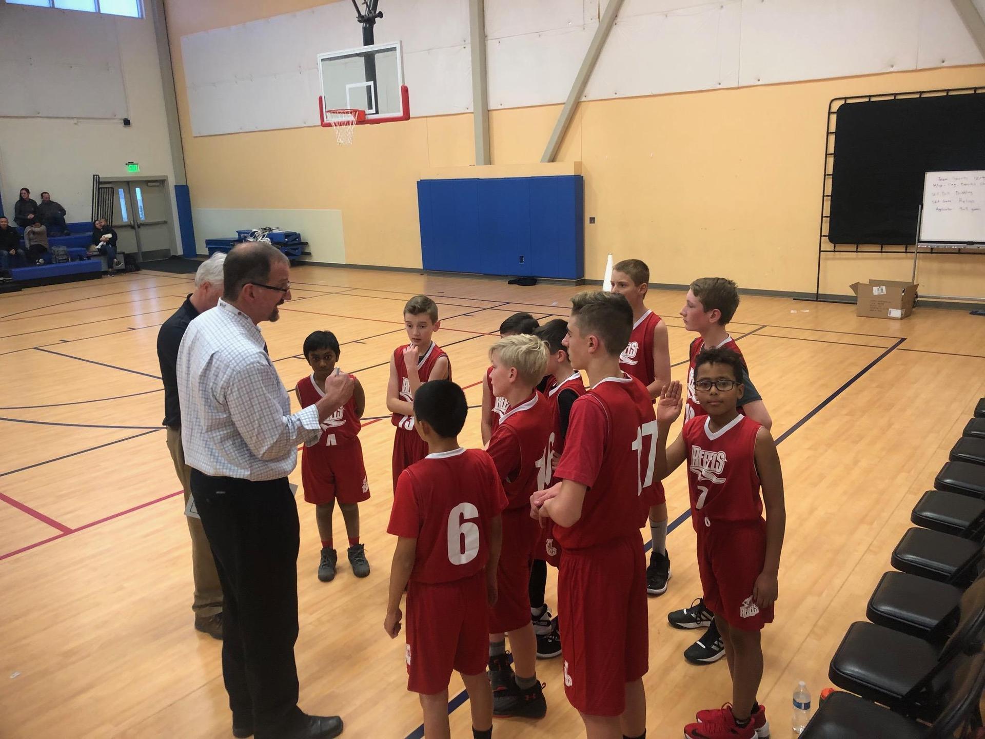 Lincoln Meadows boys basketball huddle with coach