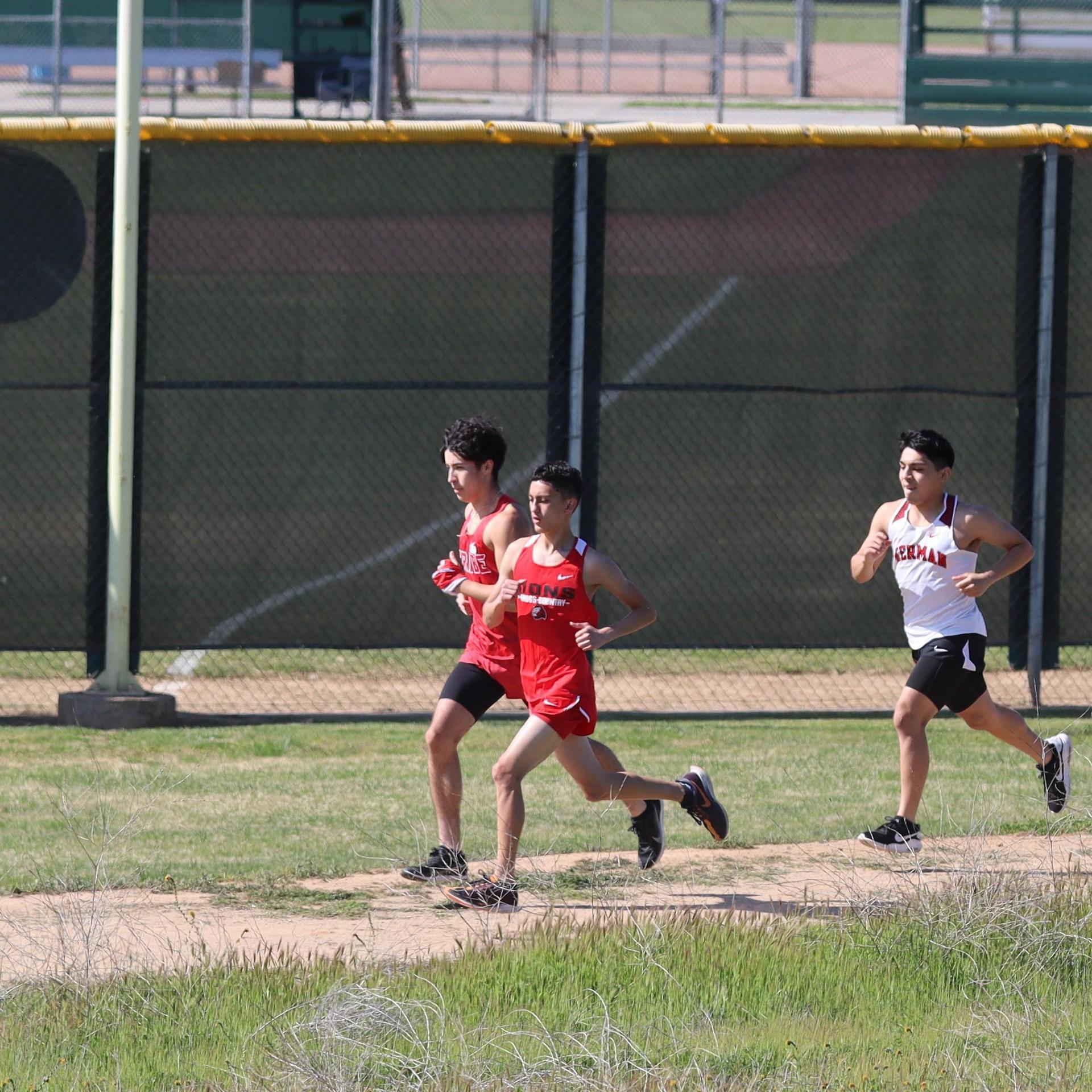 boys running at liberty high school