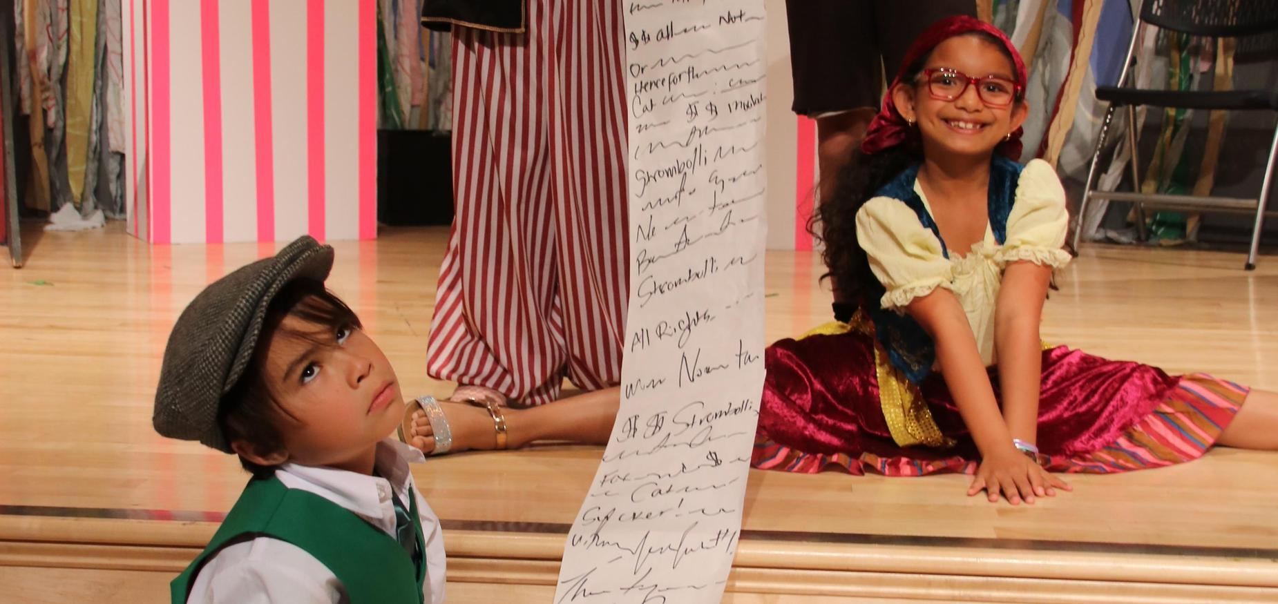 Two students from the play the Adventures of Pinocchio