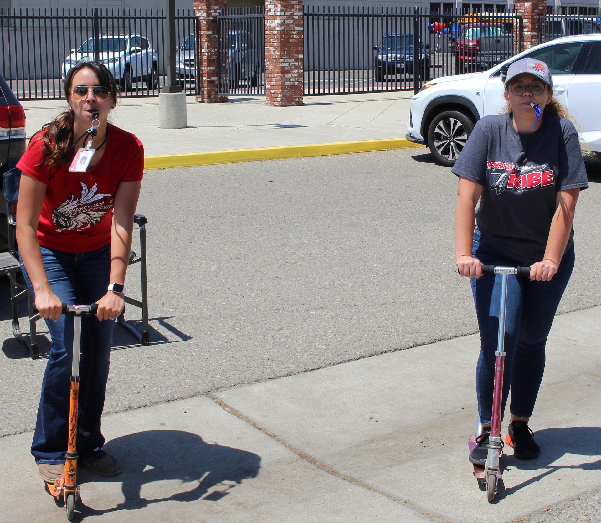 Teachers' Shane Raggio and Savannah Linhares on their scooters