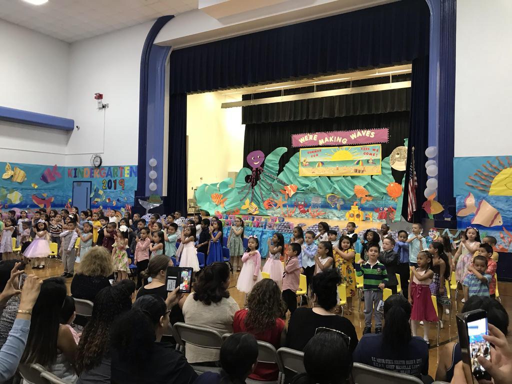 kindergartners singing and dancing