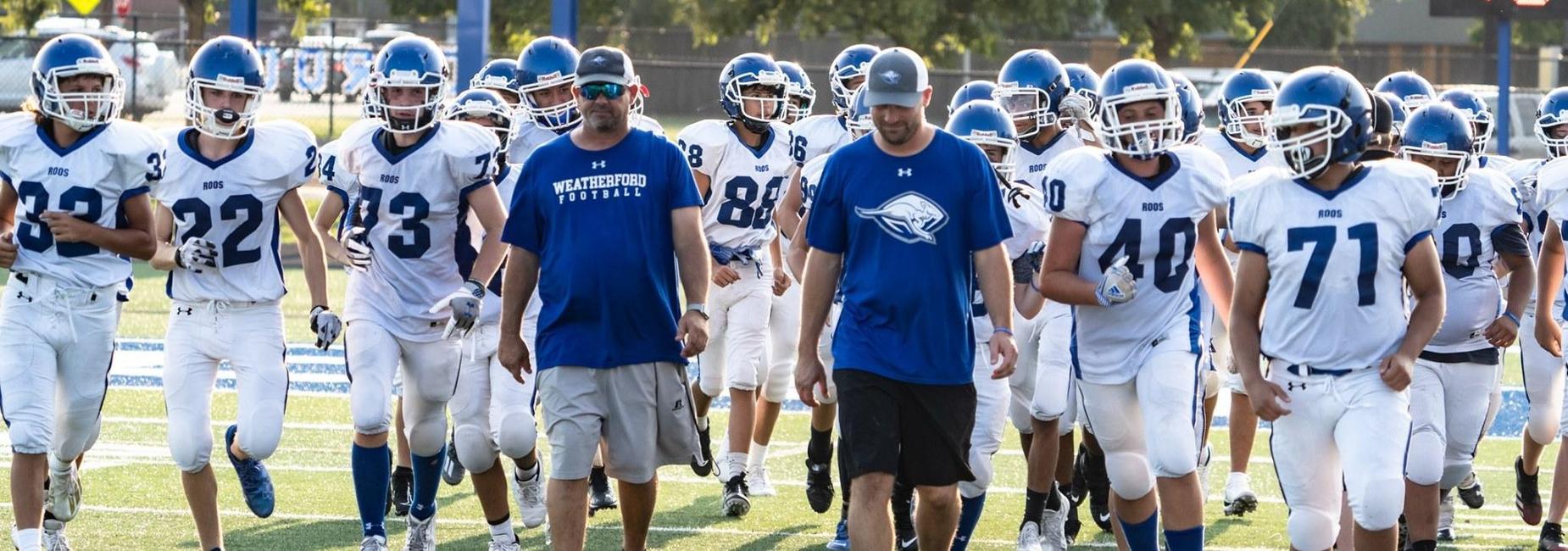Freshman football team entering the field
