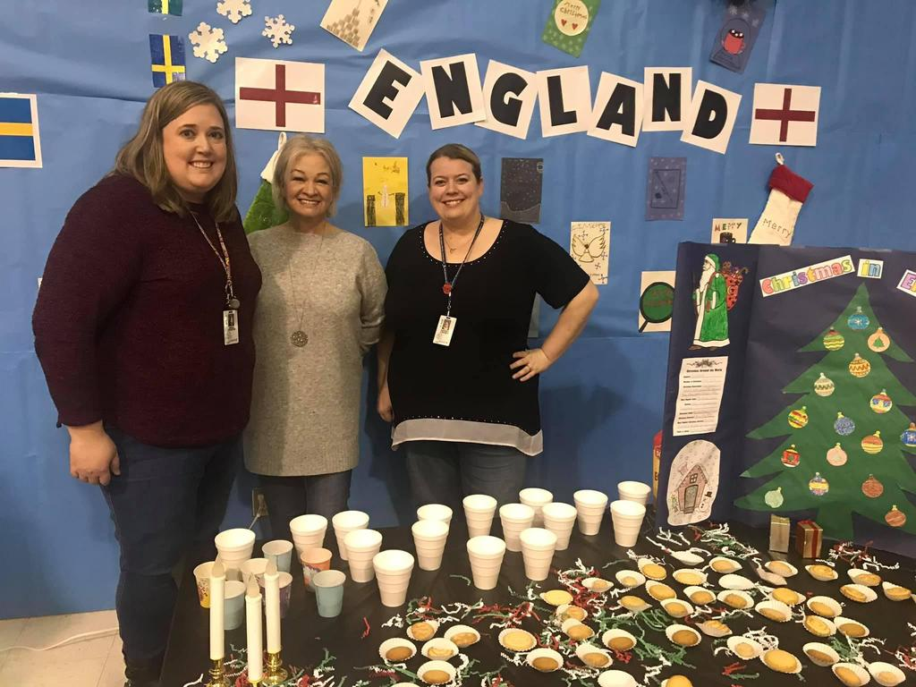 4th grade teachers with their Christmas Around the World booth