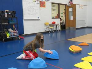 Georgia Mosely helps set up activities in PE.