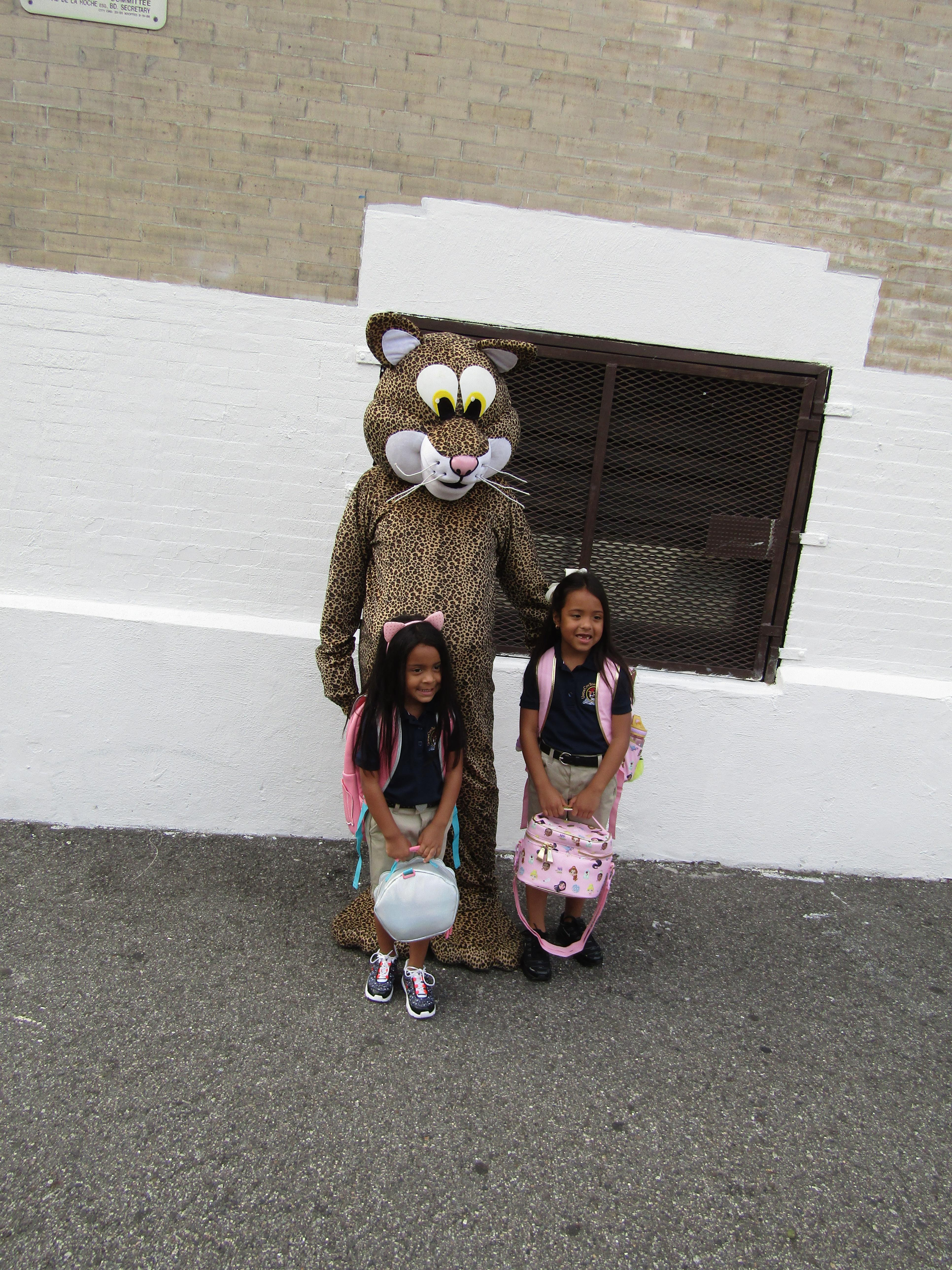 girls with school mascot