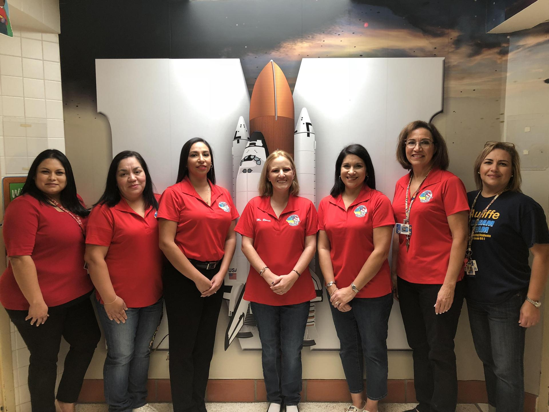 Student Support Staff posing in front of challenger.