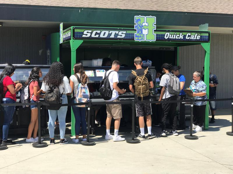 Highland High students wait in line to get lunch at the Quick Cafe.