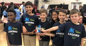 (L-R) Wilson Wright, Neev Nedungadi, Luke Jenner, Mahie Panjwani, Evan Tukaczynski, and Aaron Rudnick compete as Team Legorio during the First Lego League qualifying round, advancing to the state championship on Dec 14-15.