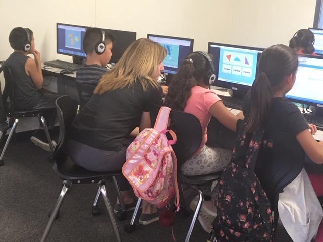 Mrs. Nolan tutoring some students.