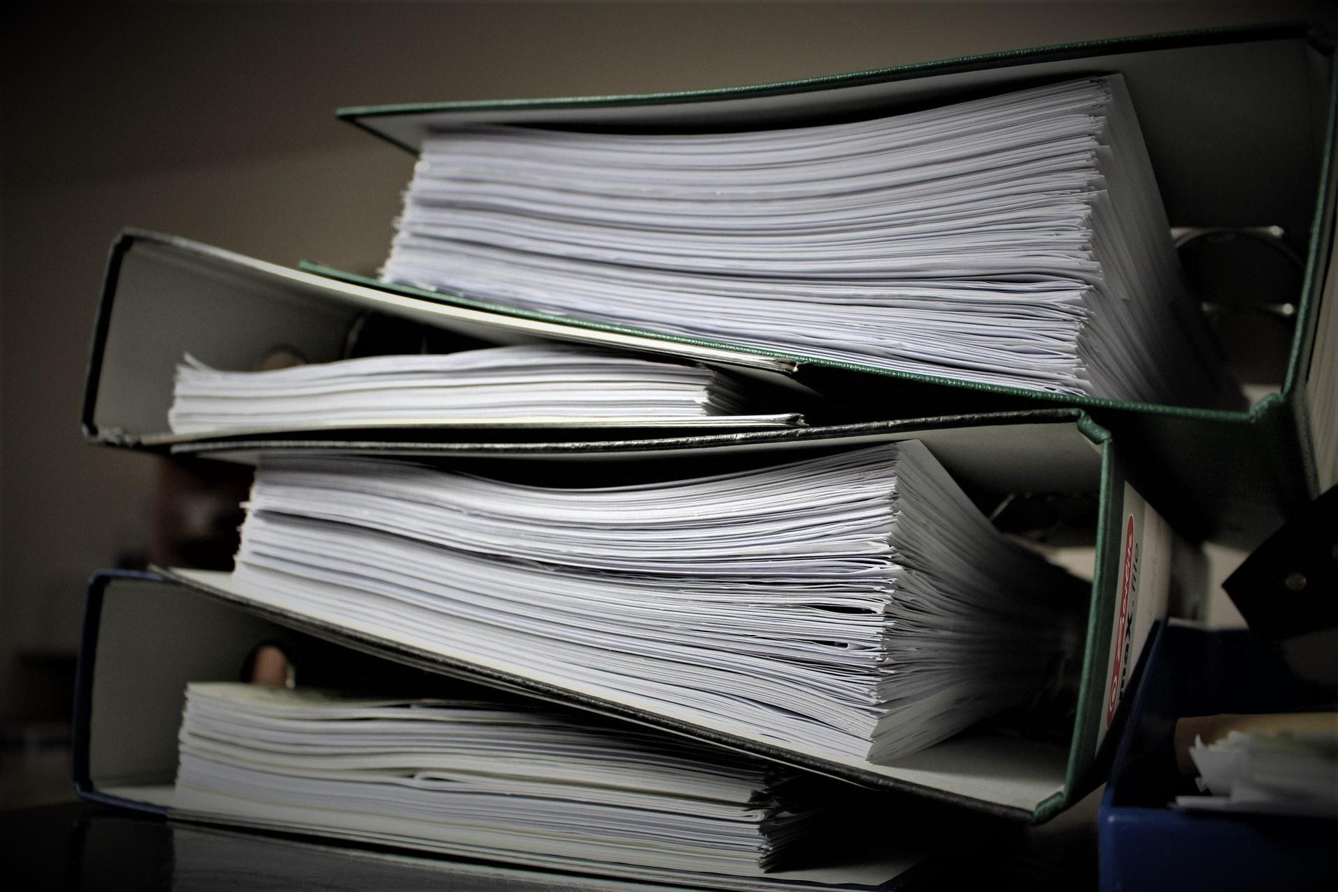 Photo of a three ring binder of transcripts