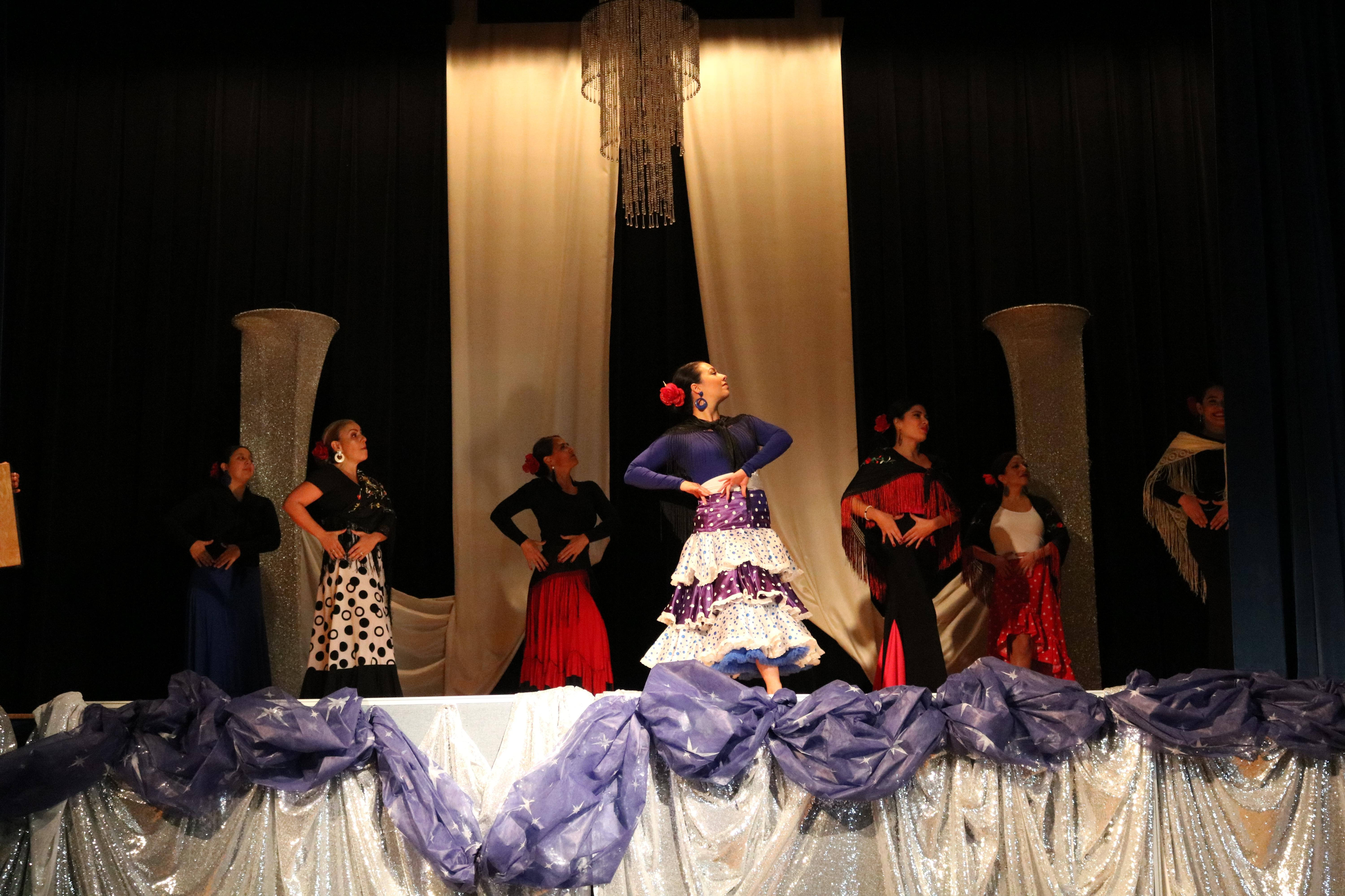 six female teachers of  CP dressed in flamenco costumes and dancing to traditional spanish music