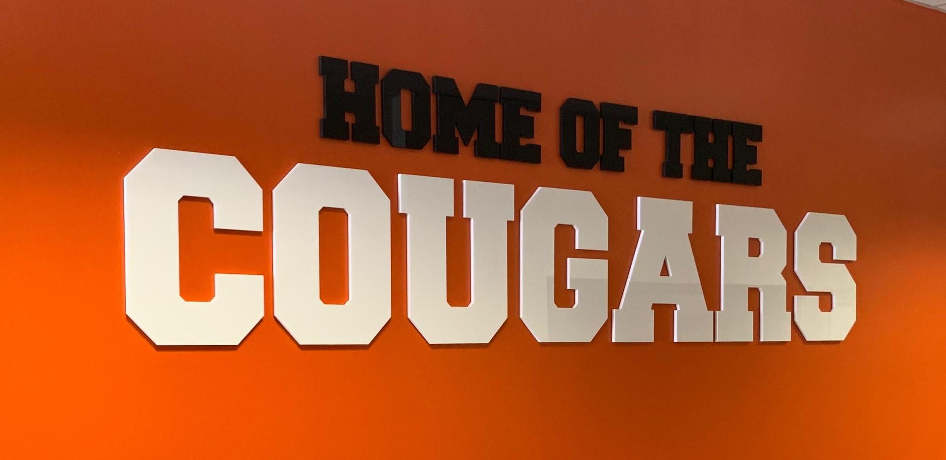 home of cougars sign