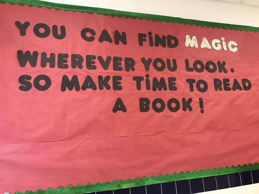 bulletin display that says you can find magic wherever you look, so make time to read a book