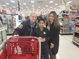 principal Reyes and student with police officer in Target