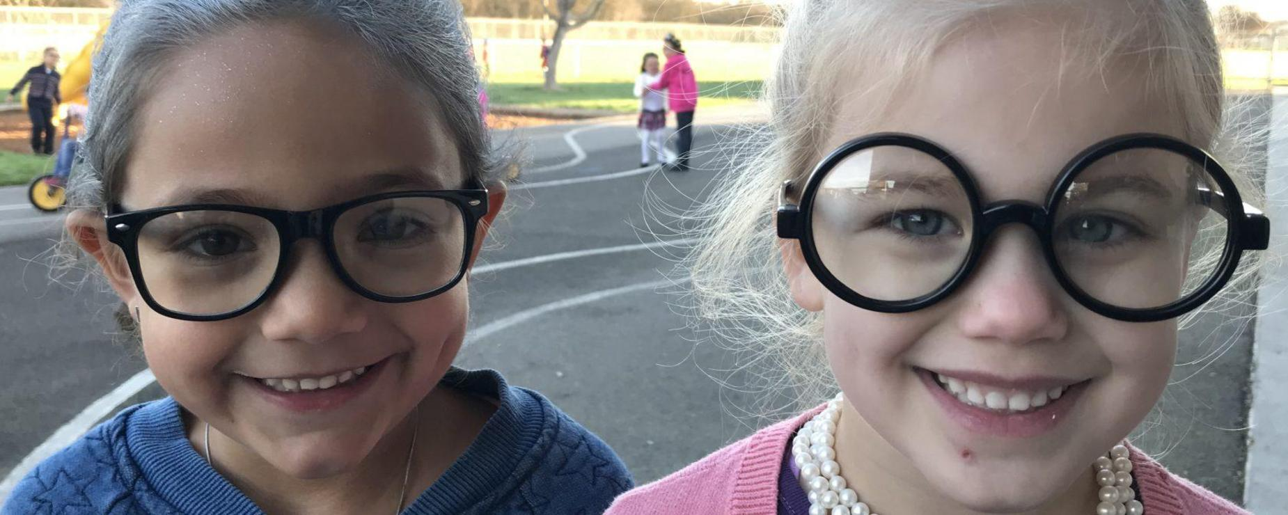 two students with glasses
