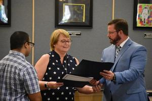 oined by Gary Medina, a representative from the offices of Rep. Steve Knight, Superintendent Steve Doyle presents a plaque and certificate of recognition to Nancy Waycott, a special education instructional aide for the last 28 years.