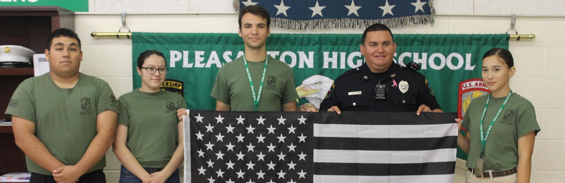 JROTC present flag to campus police