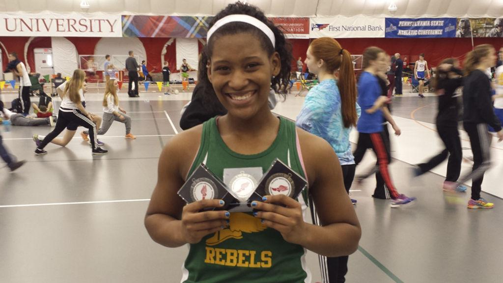 Track runner with awards
