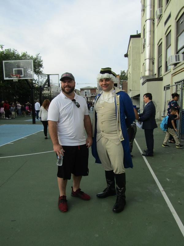 Mr. Blake and Mr. Petric dressed as Thomas Jefferson welcoming students and parents