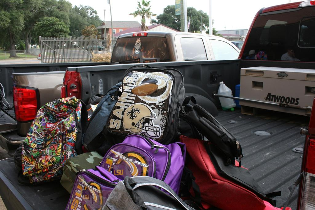 Backpacks in bed of truck