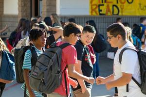 Students at Castaic Middle School give a fist-bump on campus. Gilbert Bernal / The Signal