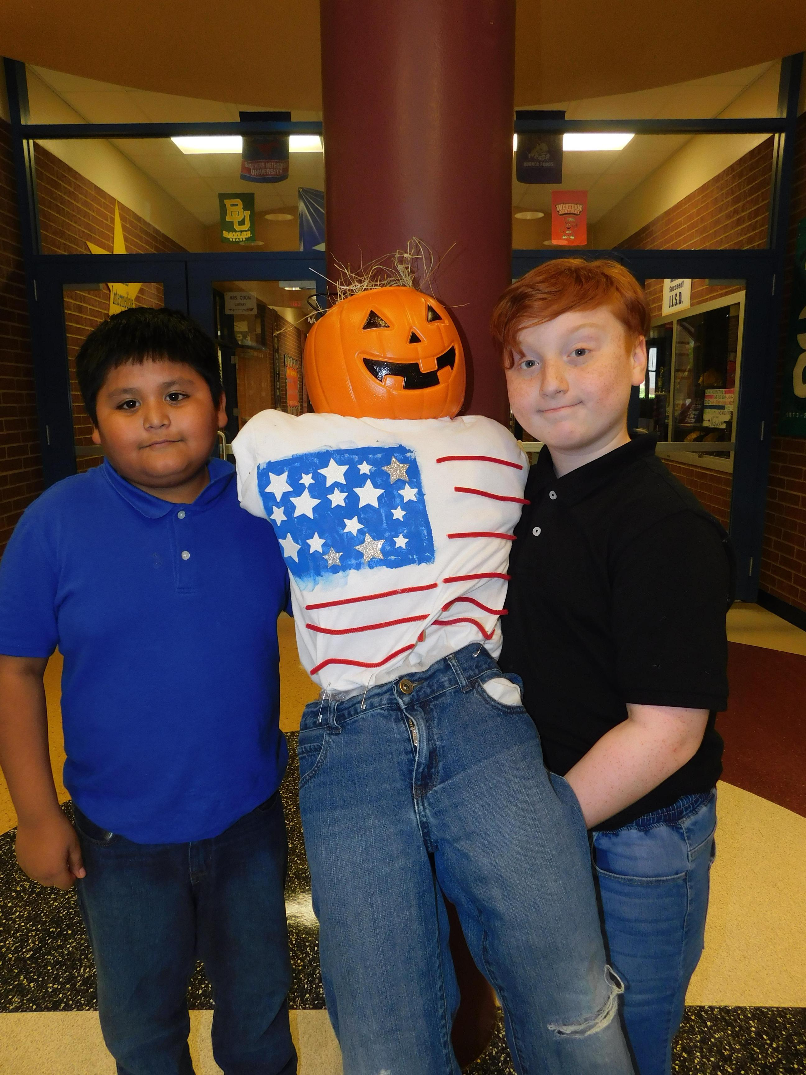 Students with scarecrow projects
