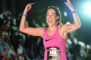 Art teacher Charlotte Buettner crossing the finish line.