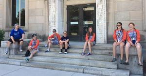 TKHS team members are pictured outside the Iowa State library.