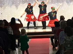 Teachers tap dancing in Talent Show.