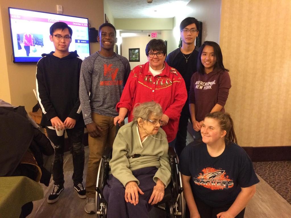 While volunteering at American House, a group of KHS students met two Kelloggsville alumni.