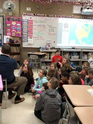 Superintendent reading to a classroom