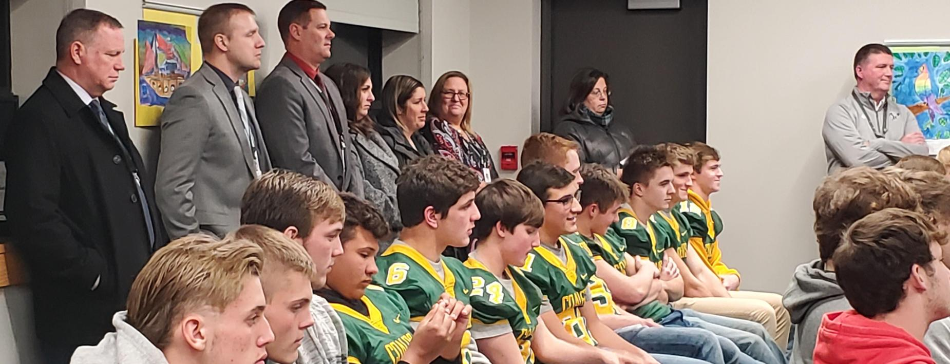 Honoring the football team at the board meeting