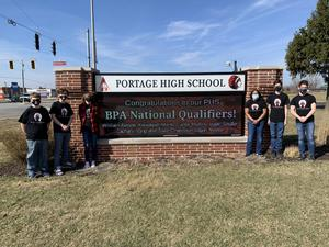 Six students standing by digital sign for BPA Nationals